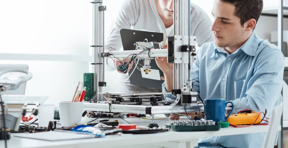 Engineering students using innovative 3D printer